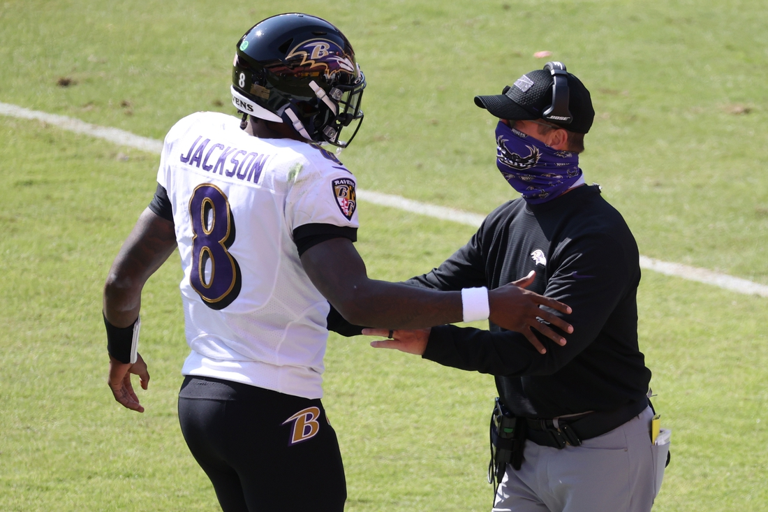 Oct 4, 2020; Landover, Maryland, USA; Baltimore Ravens quarterback Lamar Jackson (8) celebrates with Ravens head coach John Harbaugh (R) after scoring a touchdown against the Washington Football Team in the second quarter at FedExField. Mandatory Credit: Geoff Burke-USA TODAY Sports