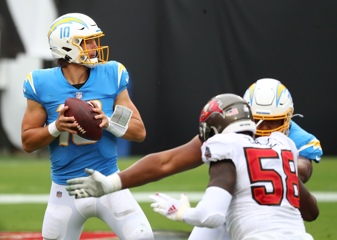 Oct 4, 2020; Tampa, Florida, USA; Los Angeles Chargers quarterback Justin Herbert (10) throws a pass against the Tampa Bay Buccaneers in the second quarter of a NFL game at Raymond James Stadium. Mandatory Credit: Kim Klement-USA TODAY Sports
