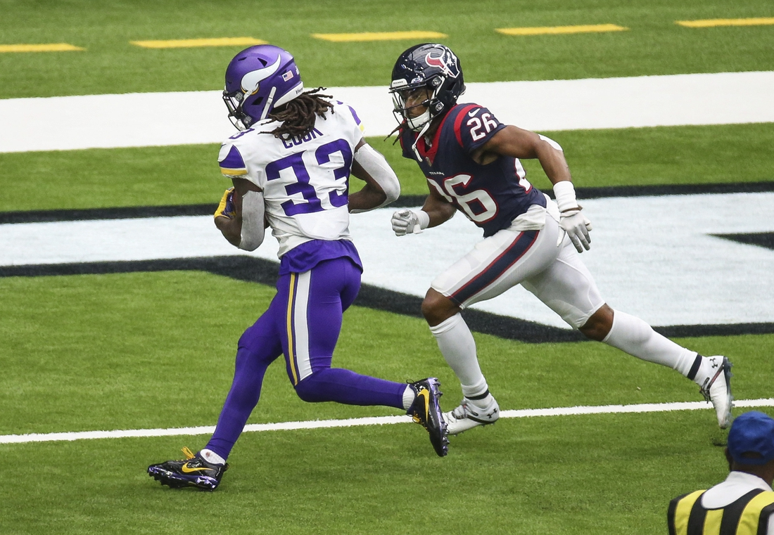 Oct 4, 2020; Houston, Texas, USA; Minnesota Vikings running back Dalvin Cook (33) runs the ball for a touchdown against Houston Texans cornerback Vernon Hargreaves III (26) during the second quarter at NRG Stadium. Mandatory Credit: Troy Taormina-USA TODAY Sports