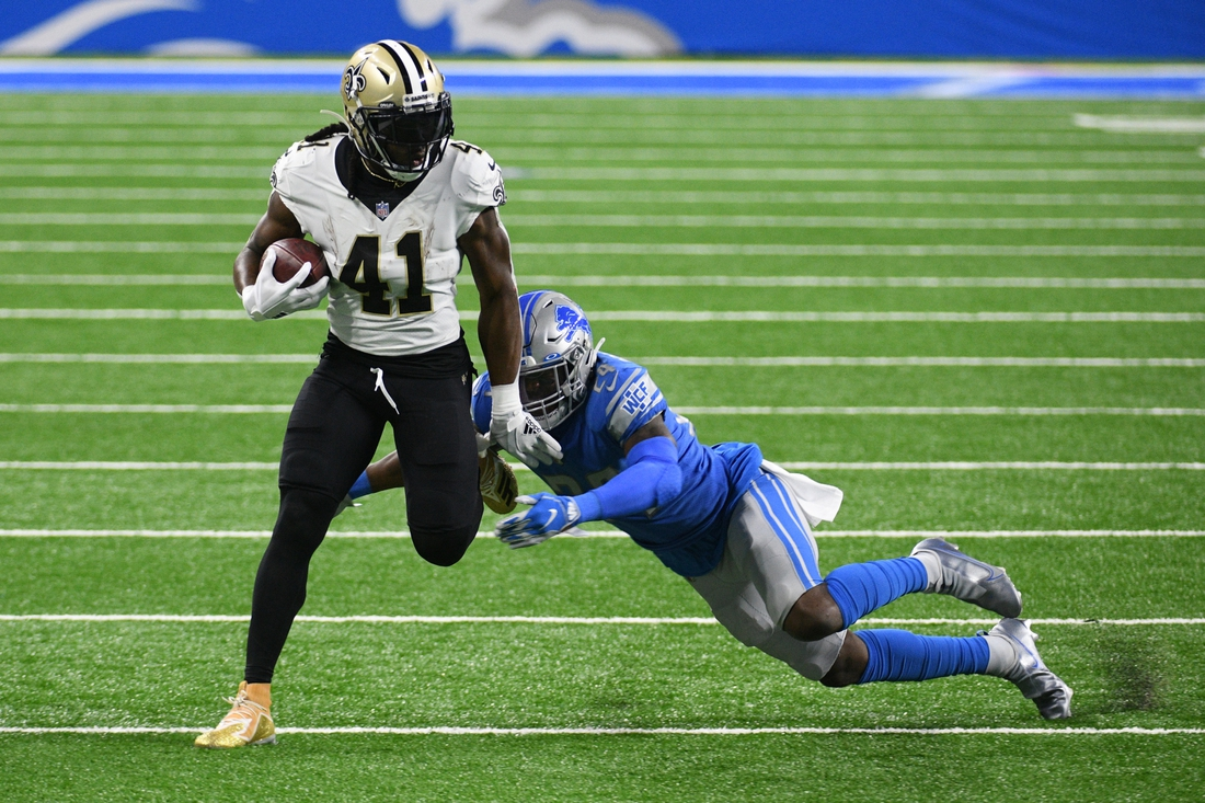 Oct 4, 2020; Detroit, Michigan, USA; New Orleans Saints running back Alvin Kamara (41) runs the ball against Detroit Lions cornerback Amani Oruwariye (24) during the second quarter at Ford Field. Mandatory Credit: Tim Fuller-USA TODAY Sports