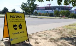 Oct 4, 2020; Nashville, Tennessee, USA;  A COVID mask sign is seen in the parking lot of Nissan Stadium on the originally scheduled day of the the Tennessee Titans game against the Pittsburgh Steelers. The game was rescheduled for October 25 at Nissan Stadium. Mandatory Credit: Christopher Hanewinckel-USA TODAY Sports