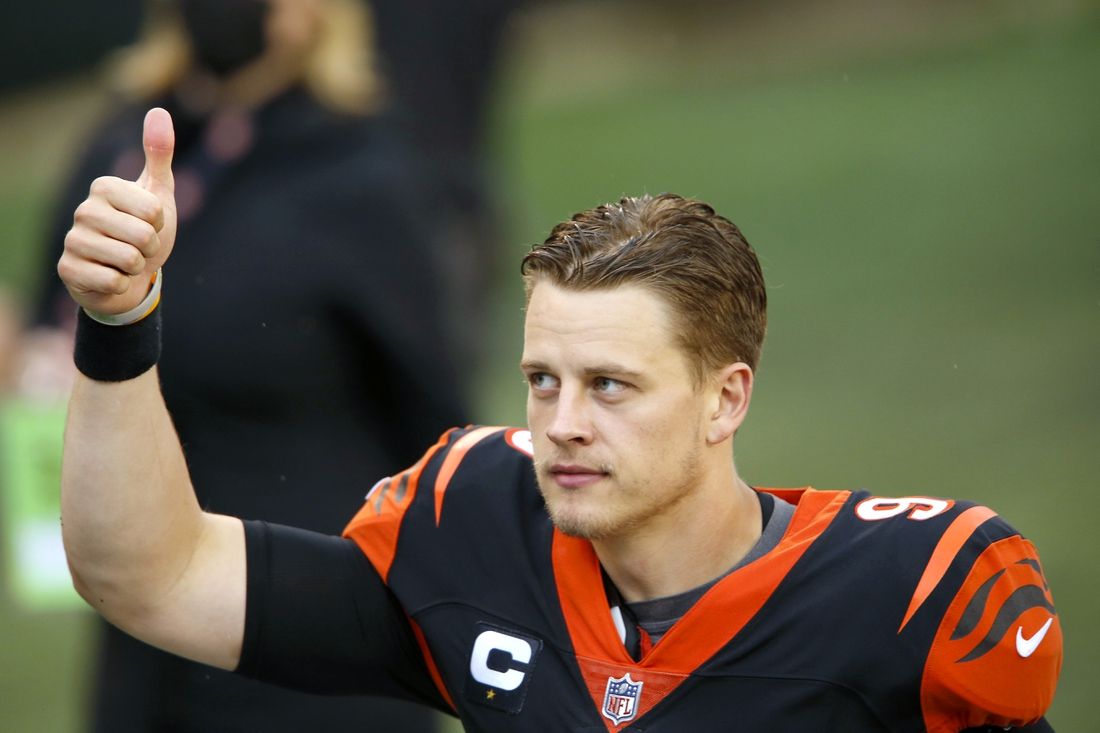 Oct 4, 2020; Cincinnati, Ohio, USA; Cincinnati Bengals quarterback Joe Burrow (9) flashes the thumbs up after his first win the the NFL following the game over the Jacksonville Jaguars at Paul Brown Stadium. Mandatory Credit: Joseph Maiorana-USA TODAY Sports