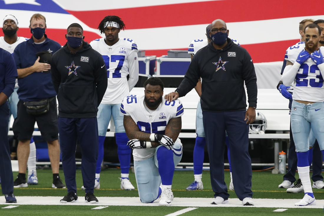 Oct 4, 2020; Arlington, Texas, USA; Dallas Cowboys defensive tackle Dontari Poe (95) kneels during the national anthem before the game against the Cleveland Browns at AT&T Stadium. Mandatory Credit: Tim Heitman-USA TODAY Sports
