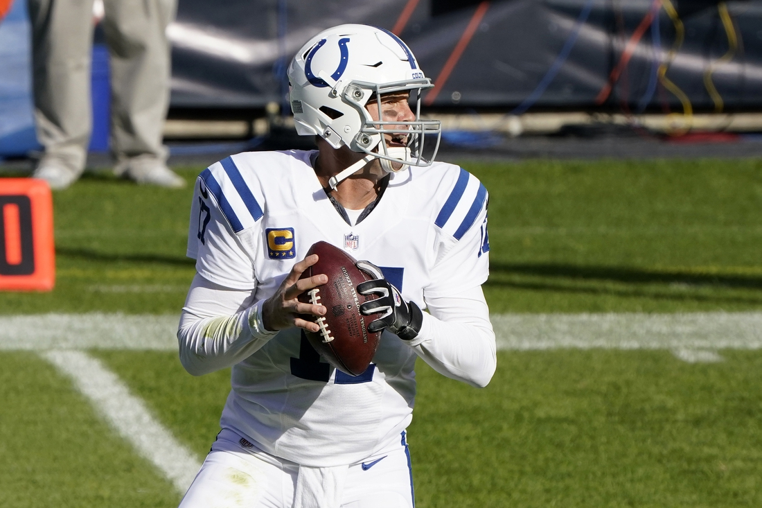 Oct 4, 2020; Chicago, Illinois, USA; Indianapolis Colts quarterback Philip Rivers (17) drops back to pass against the Chicago Bears during the first quarter at Soldier Field. Mandatory Credit: Mike Dinovo-USA TODAY Sports