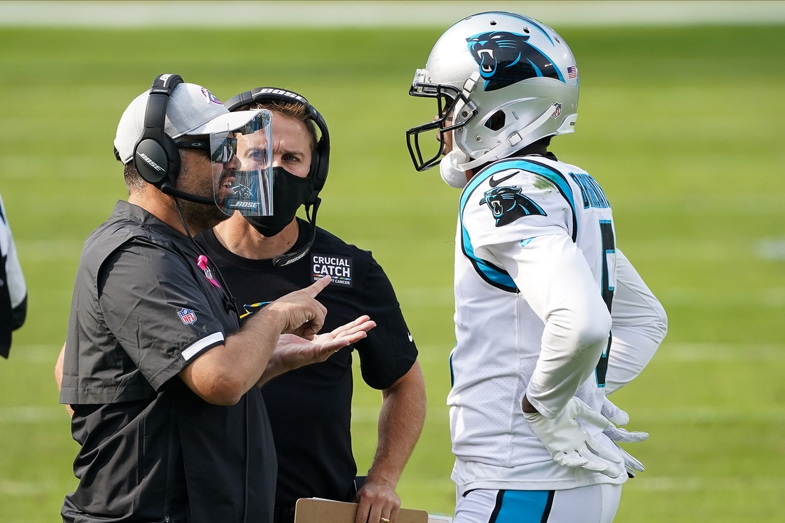 Oct 4, 2020; Charlotte, North Carolina, USA; Carolina Panthers head coach Matt Rhule talks with quarterback Teddy Bridgewater (5) during the second half against the Arizona Cardinals at Bank of America Stadium. Mandatory Credit: Jim Dedmon-USA TODAY Sports