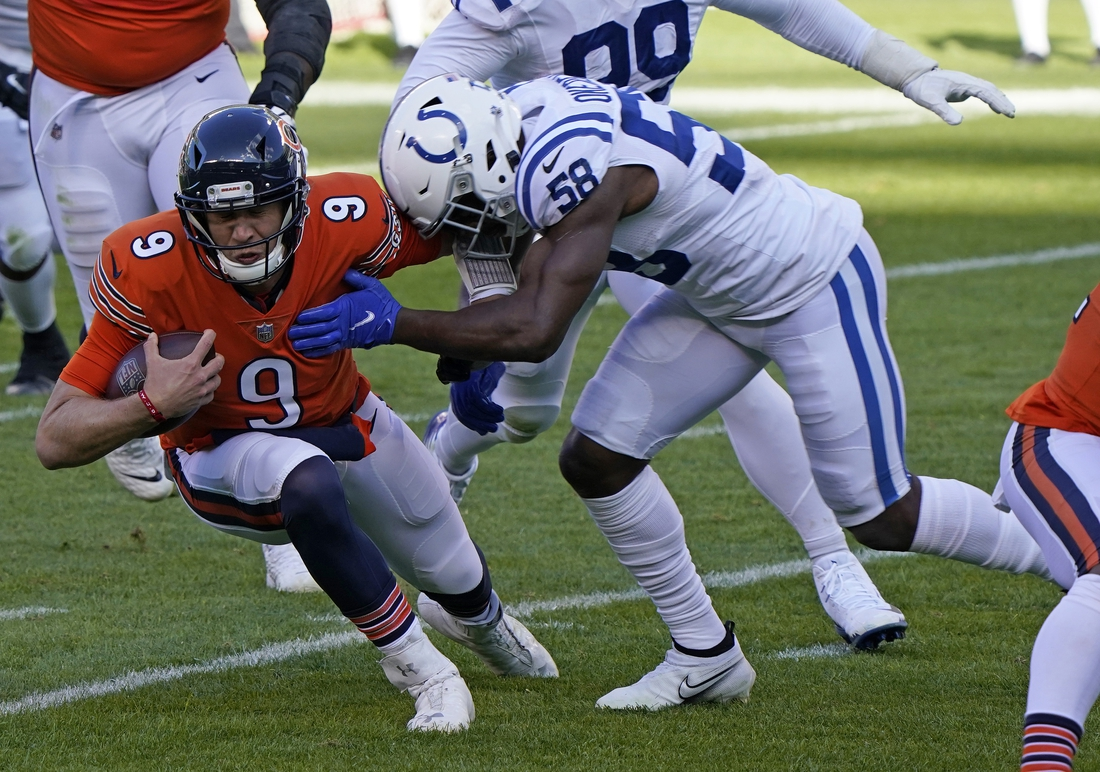 Oct 4, 2020; Chicago, Illinois, USA; Chicago Bears quarterback Nick Foles (9) rushes the ball against Indianapolis Colts inside linebacker Bobby Okereke (58) during the second quarter at Soldier Field. Mandatory Credit: Mike Dinovo-USA TODAY Sports