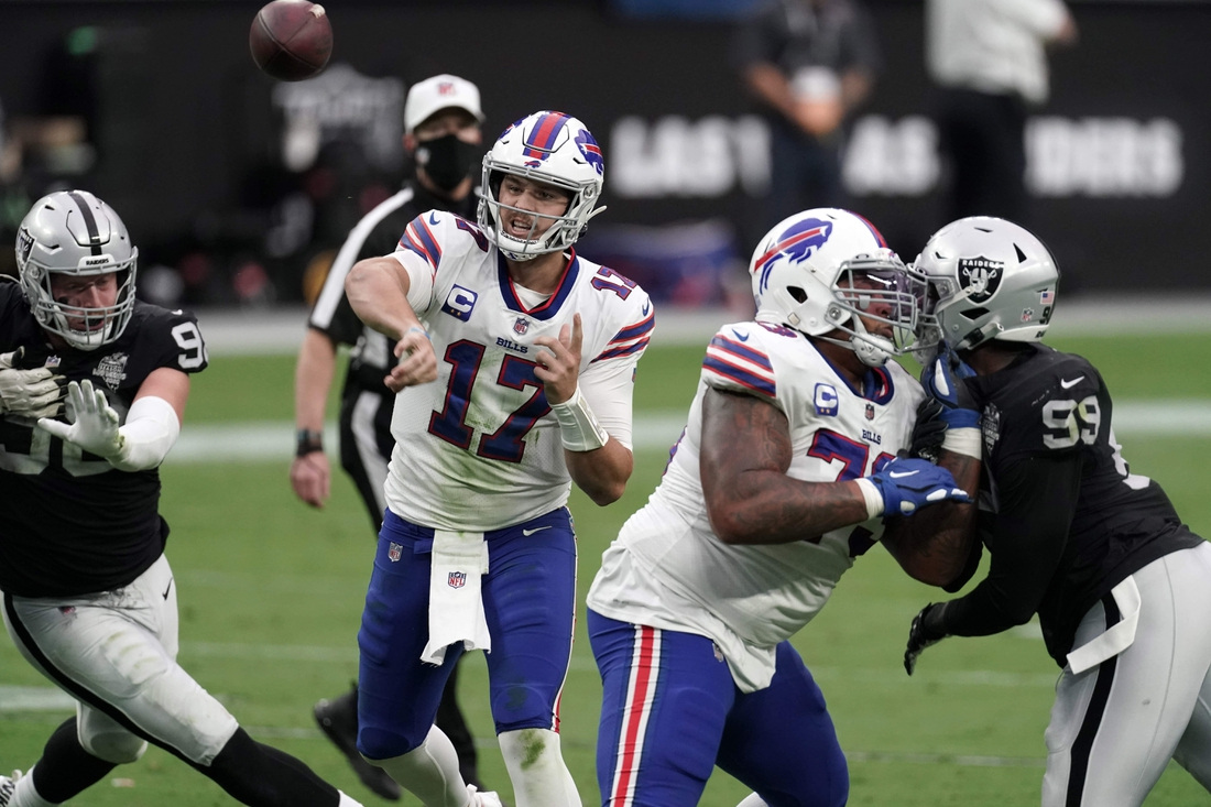 Oct 4, 2020; Paradise, Nevada, USA; Buffalo Bills quarterback Josh Allen (17) throws the ball against the Las Vegas Raiders in the second quarter at Allegiant Stadium. Mandatory Credit: Kirby Lee-USA TODAY Sports