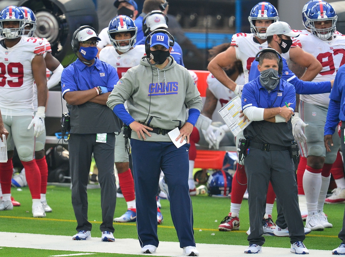 Oct 4, 2020; Inglewood, California, USA; New York Giants head coach Joe Judge (center) watches game action against the Los Angeles Rams during the second half at SoFi Stadium. Mandatory Credit: Gary A. Vasquez-USA TODAY Sports