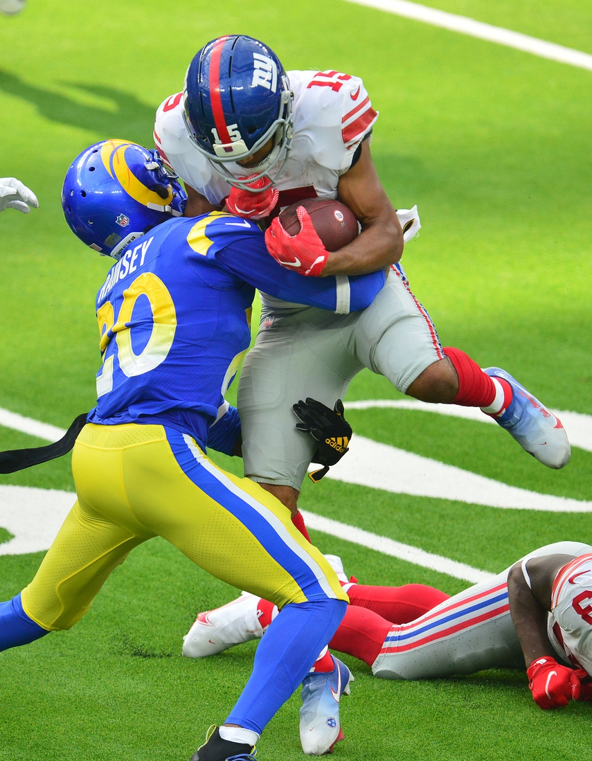Oct 4, 2020; Inglewood, California, USA; New York Giants wide receiver Golden Tate (15) is brought down by Los Angeles Rams cornerback Jalen Ramsey (20) during the second half at SoFi Stadium. Mandatory Credit: Gary A. Vasquez-USA TODAY Sports
