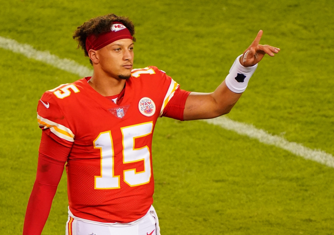 Oct 5, 2020; Kansas City, Missouri, USA; Kansas City Chiefs quarterback Patrick Mahomes (15) gestures to the crowd after defeating the New England Patriots in a NFL game at Arrowhead Stadium. Mandatory Credit: Jay Biggerstaff-USA TODAY Sports