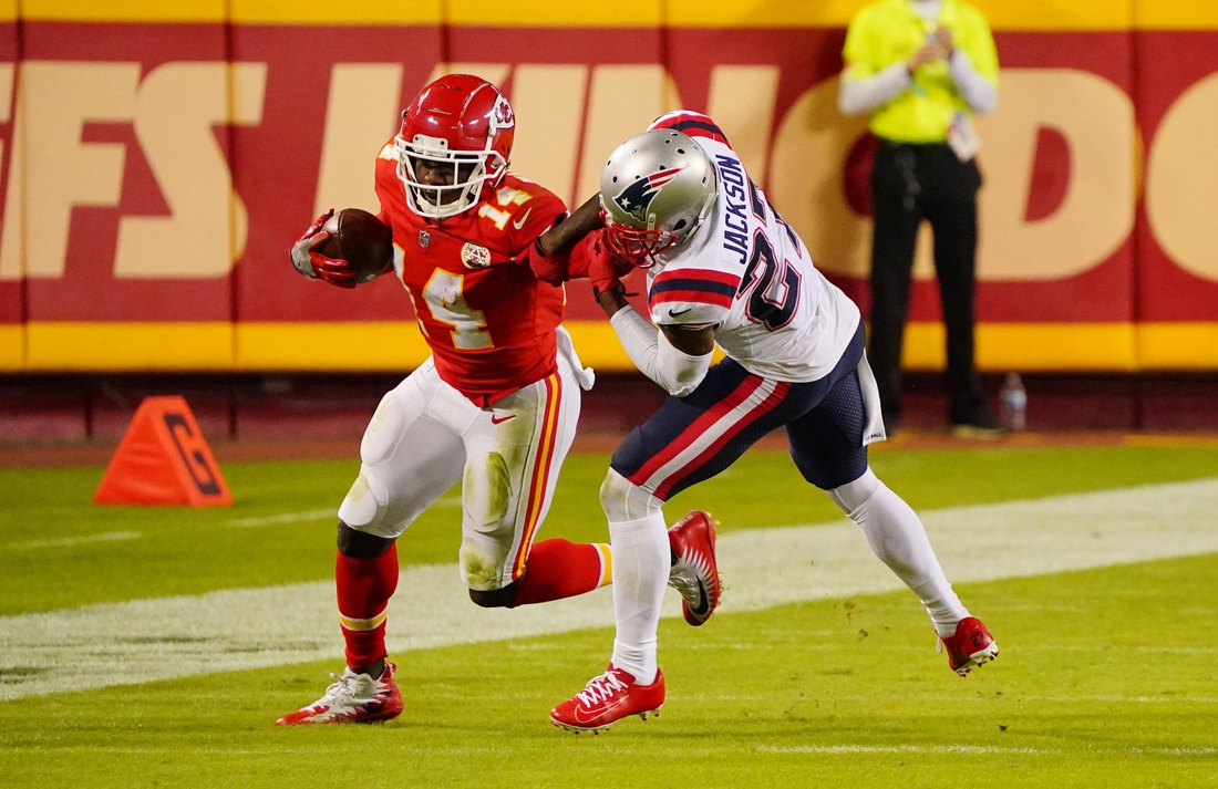 Oct 5, 2020; Kansas City, Missouri, USA; Kansas City Chiefs wide receiver Sammy Watkins (14) is tackled by New England Patriots defensive back J.C. Jackson (27) during the third quarter of a NFL game at Arrowhead Stadium. Mandatory Credit: Jay Biggerstaff-USA TODAY Sports