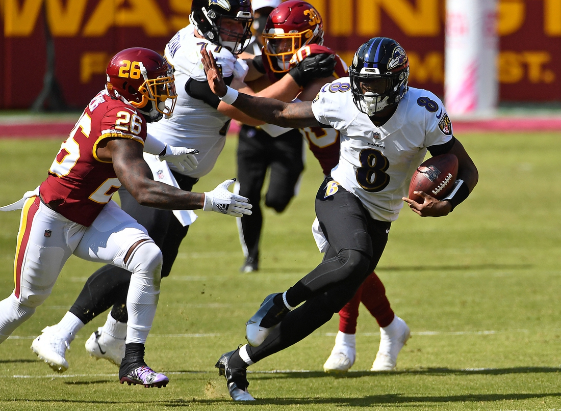 Oct 4, 2020; Landover, Maryland, USA; Baltimore Ravens quarterback Lamar Jackson (8) runs for a 50 yard touchdown against the Washington Football Team during the second quarter at FedExField. Mandatory Credit: Brad Mills-USA TODAY Sports