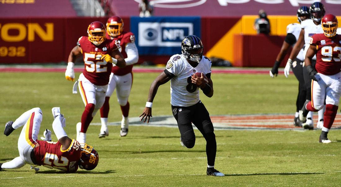 Oct 4, 2020; Landover, Maryland, USA; Baltimore Ravens quarterback Lamar Jackson (8) runs for a 50 yard touchdown against the Washington Football Team during the second quarter at FedExField. Mandatory Credit: Brad Mills-USA TODAY Sports