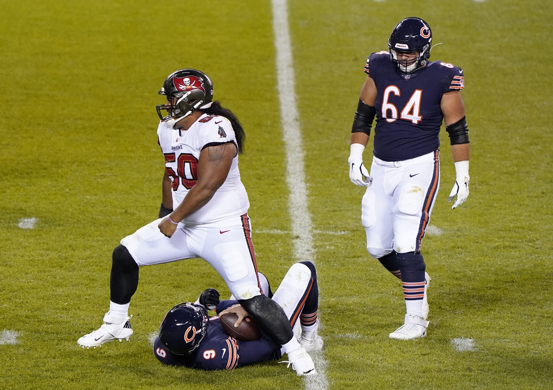 Oct 8, 2020; Chicago, Illinois, USA; Tampa Bay Buccaneers nose tackle Vita Vea (50) sacks Chicago Bears quarterback Nick Foles (9) during the third quarter at Soldier Field. Mandatory Credit: Mike Dinovo-USA TODAY Sports