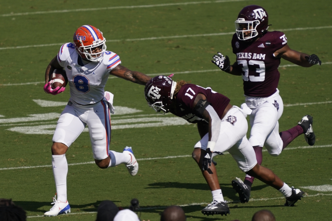 Oct 10, 2020; College Station, Texas, USA; Florida Gators wide receiver Trevon Grimes (8) runs for yards after catching a pass as Texas A&M Aggies defensive back Jaylon Jones (17) attempts to make the tackle in the first quarter at Kyle Field. Mandatory Credit: Scott Wachter-USA TODAY Sports