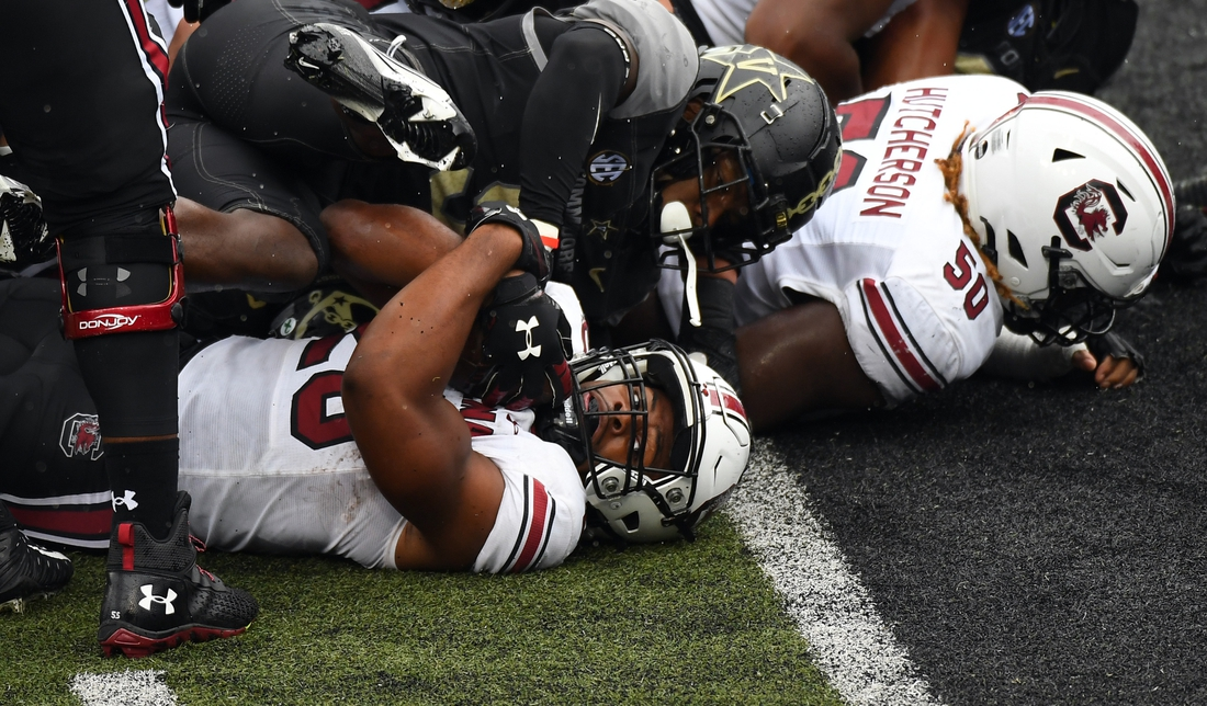 Oct 10, 2020; Nashville, Tennessee, USA; South Carolina Gamecocks running back Kevin Harris (20) is stopped short of the goal line during the first half against the Vanderbilt Commodores at Vanderbilt Stadium. Mandatory Credit: Christopher Hanewinckel-USA TODAY Sports