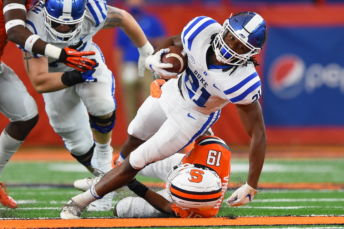 Oct 10, 2020; Syracuse, New York, USA; Duke Blue Devils running back Mataeo Durant (21) runs with the ball as Syracuse Orange defensive back Robert Hanna (19) defends during the first quarter at the Carrier Dome. Mandatory Credit: Rich Barnes-USA TODAY Sports