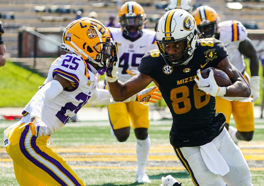Oct 10, 2020; Columbia, Missouri, USA; Missouri Tigers wide receiver Tauskie Dove (86) runs against LSU Tigers cornerback Cordale Flott (25) during the first half at Faurot Field at Memorial Stadium. Mandatory Credit: Jay Biggerstaff-USA TODAY Sports