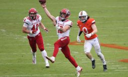 Oct 10, 2020; Charlottesville, Virginia, USA; North Carolina State Wolfpack quarterback Devin Leary (13) passes the ball as Virginia Cavaliers linebacker Zane Zandier (0) chases in the second quarter at Scott Stadium. Mandatory Credit: Geoff Burke-USA TODAY Sports