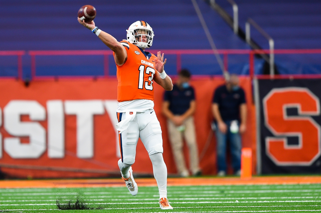 Oct 10, 2020; Syracuse, New York, USA; Syracuse Orange quarterback Tommy DeVito (13) passes the ball against the Duke Blue Devils during the second quarter at the Carrier Dome. Mandatory Credit: Rich Barnes-USA TODAY Sports