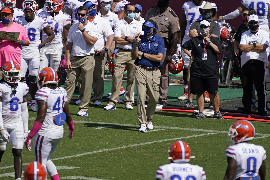 Oct 10, 2020; College Station, Texas, USA; Florida Gators head coach Dan Mullen calls a play during the second quarter against the Texas A&M Aggies at Kyle Field. Mandatory Credit: Scott Wachter-USA TODAY Sports