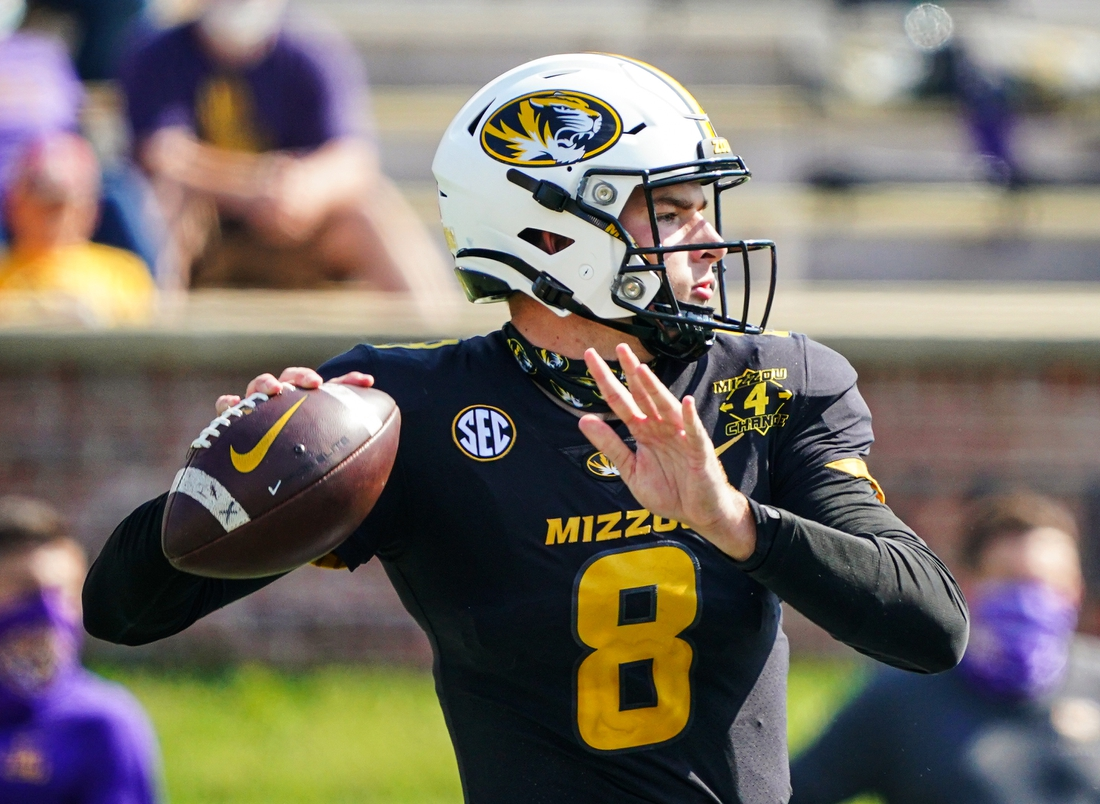 Oct 10, 2020; Columbia, Missouri, USA; Missouri Tigers quarterback Connor Bazelak (8) throws a pass against the LSU Tigers defends during the second half at Faurot Field at Memorial Stadium. Mandatory Credit: Jay Biggerstaff-USA TODAY Sports