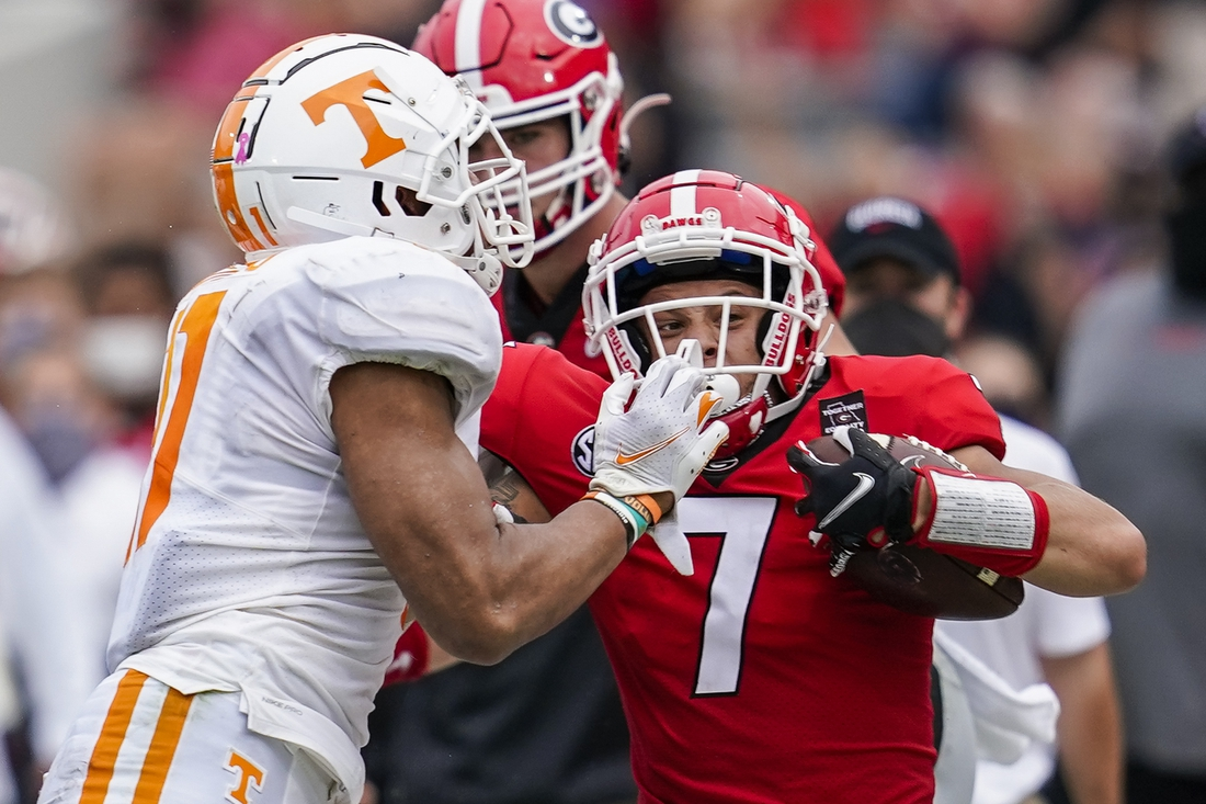 Oct 10, 2020; Athens, Georgia, USA; Georgia Bulldogs wide receiver Jermaine Burton (7) gets pushed out of bounds by Tennessee Volunteers linebacker Henry To'o To'o (11)  during the first half at Sanford Stadium. Mandatory Credit: Dale Zanine-USA TODAY Sports