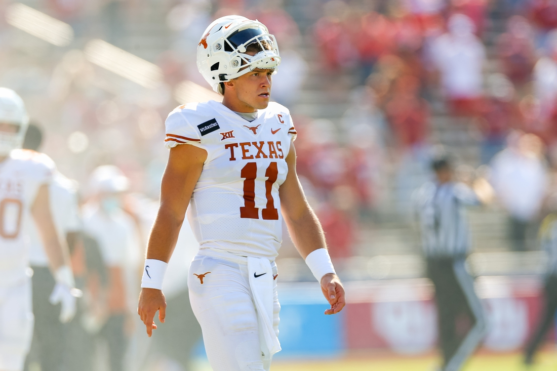 Oct 10, 2020; Dallas, Texas, USA; Texas Longhorns quarterback Sam Ehlinger (11) paces the sideline during the first quarter of the Red River Showdown against the Oklahoma Sooners at Cotton Bowl. Mandatory Credit: Andrew Dieb-USA TODAY Sports
