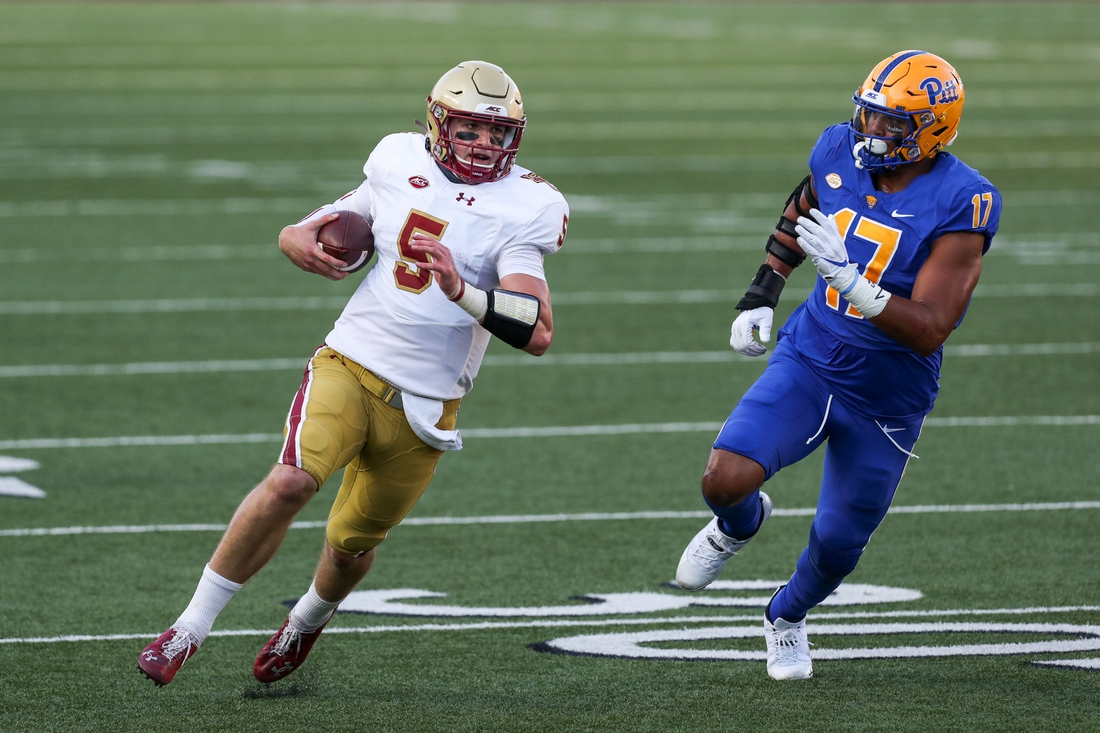 Oct 10, 2020; Chestnut Hill, Massachusetts, USA; Boston College Eagles quarterback Phil Jurkovec (5) runs the ball during the first half against the Pittsburgh Panthers at Alumni Stadium. Mandatory Credit: Paul Rutherford-USA TODAY Sports
