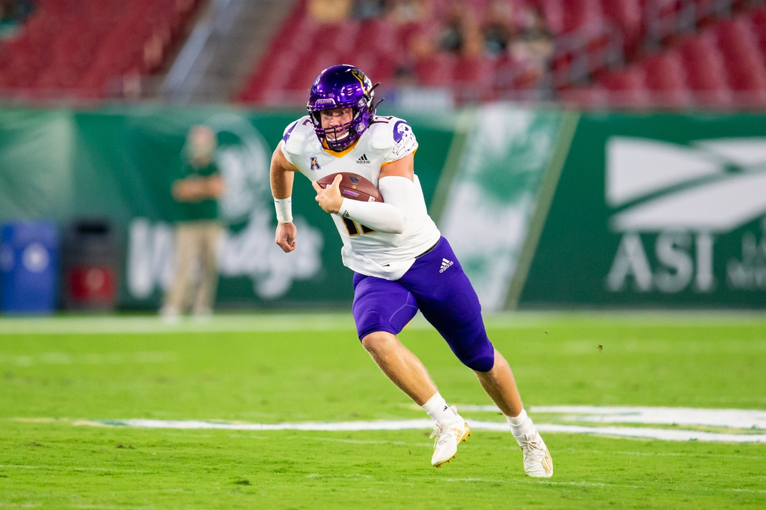 Oct 10, 2020; Tampa, Florida, USA;  East Carolina Pirates quarterback Holton Ahlers (12) rushes during the first quarter of a game against the South Florida Bulls at Raymond James Stadium. Mandatory Credit: Mary Holt-USA TODAY Sports