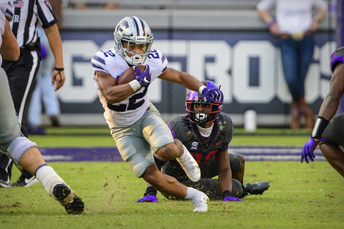 Oct 10, 2020; Fort Worth, Texas, USA; Kansas State Wildcats running back Deuce Vaughn (22) runs against the TCU Horned Frogs defense during the second half at Amon G. Carter Stadium. Mandatory Credit: Jerome Miron-USA TODAY Sports