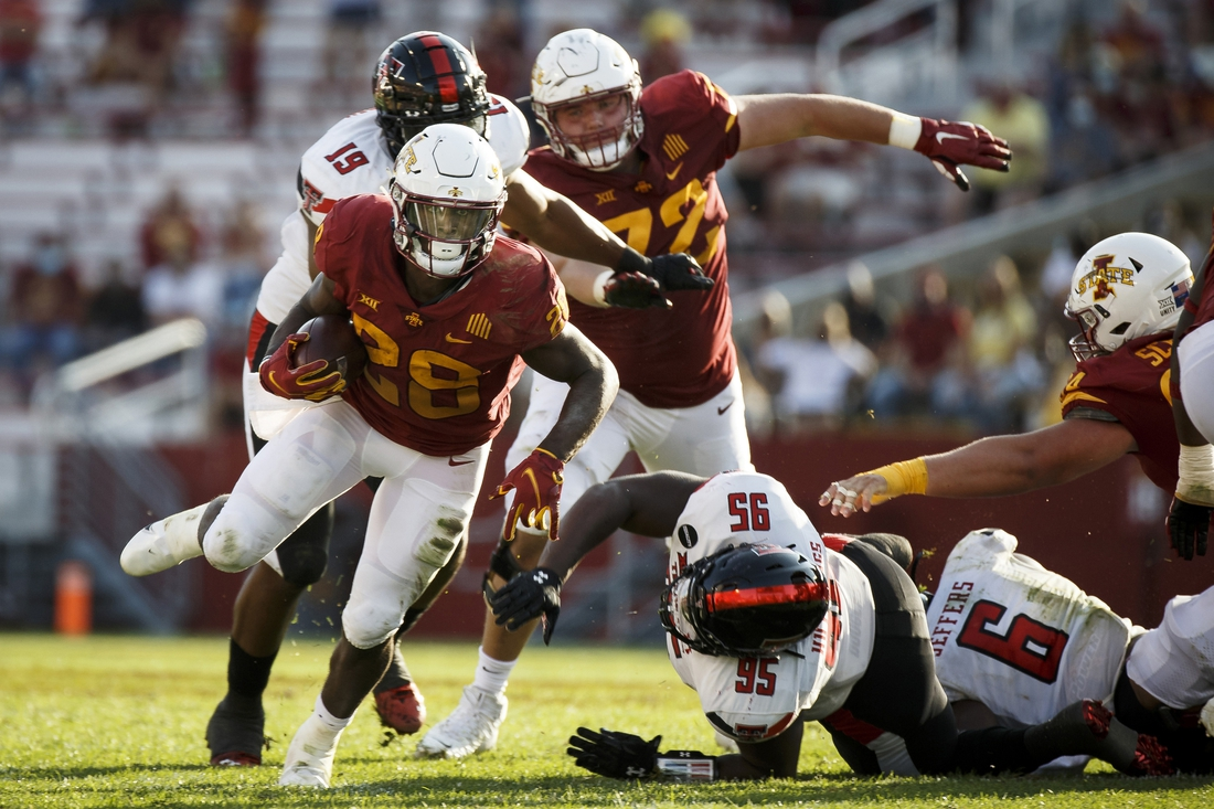 Oct 10, 2020; Ames, Iowa, USA; Iowa State Cyclones running back Breece Hall (28) runs the ball against the Texas Tech Red Raiders at Jack Trice Stadium. Mandatory Credit: Brian Powers-USA TODAY Sports.