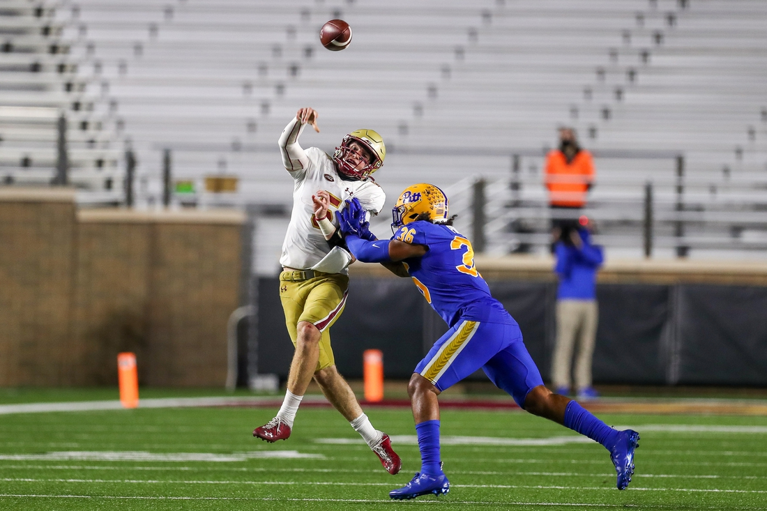 Oct 10, 2020; Chestnut Hill, Massachusetts, USA; Boston College Eagles quarterback Phil Jurkovec (5) passes the ball while defended by Pittsburgh Panthers linebacker Chase Pine (36) at Alumni Stadium. Mandatory Credit: Paul Rutherford-USA TODAY Sports