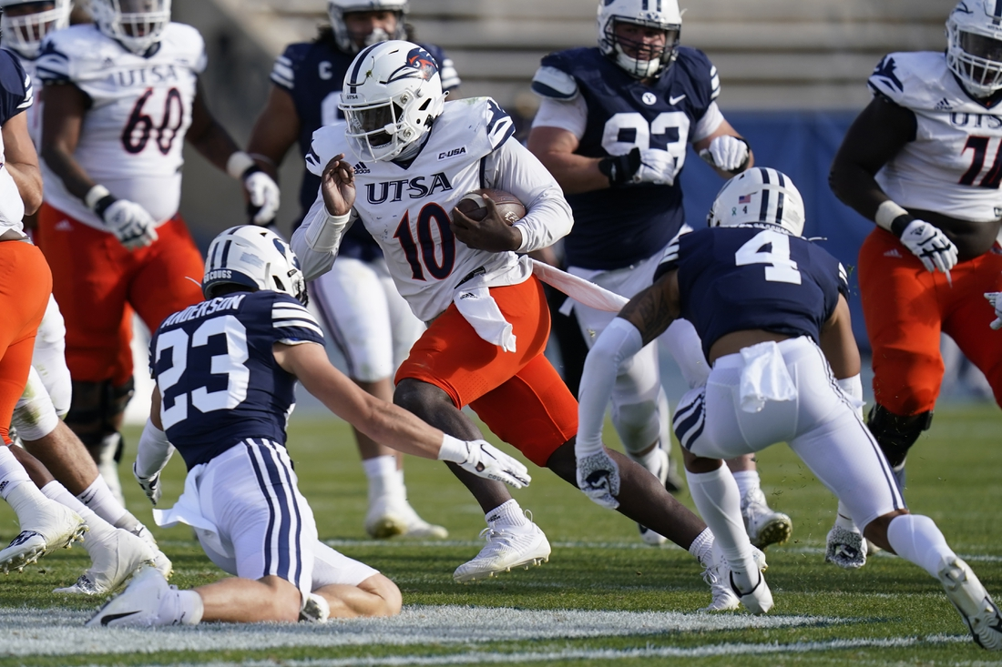 Oct 10, 2020; Provo, UT, USA; UTSA quarterback Lowell Narcisse (10) carries the ball as BYU s Zayne Anderson (23) and Troy Warner (4) close in for a tackle in the second half during an NCAA college football game Saturday, Oct. 10, 2020, in Provo, Utah.   Mandatory Credit: Rick Bowmer/Pool Photo-USA TODAY Sports