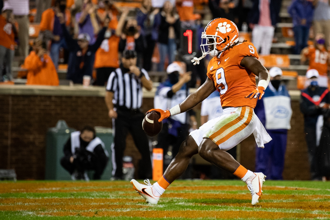 Oct 10, 2020; Clemson, South Carolina, USA; Clemson Tigers running back Travis Etienne (9) scores a touchdown against the Miami Hurricanes during the second quarter at Memorial Stadium. Mandatory Credit: Ken Ruinard-USA TODAY Sports
