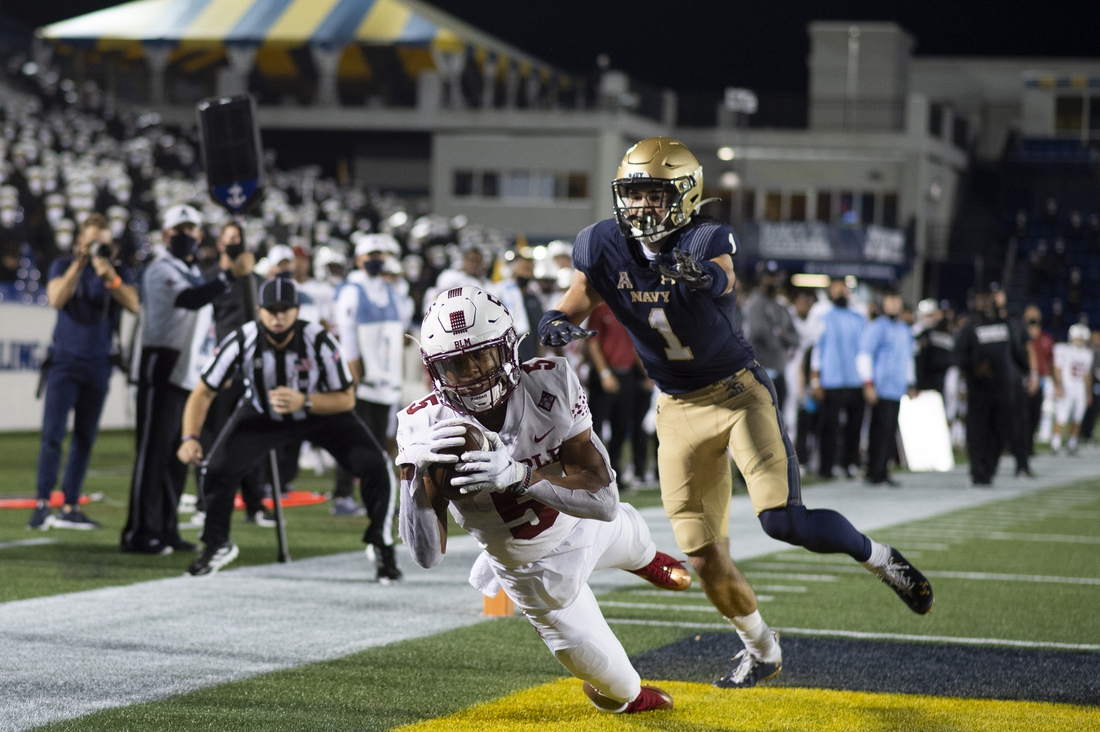 Oct 10, 2020; Annapolis, Maryland, USA;  Temple Owls wide receiver Jadan Blue (5) divers to make a reception in front of Navy Midshipmen linebacker John Marshall (1) during the second half at Navy-Marine Corps Memorial Stadium.The catch was overturned due to a Navy Midshipmen penalty  Mandatory Credit: Tommy Gilligan-USA TODAY Sports