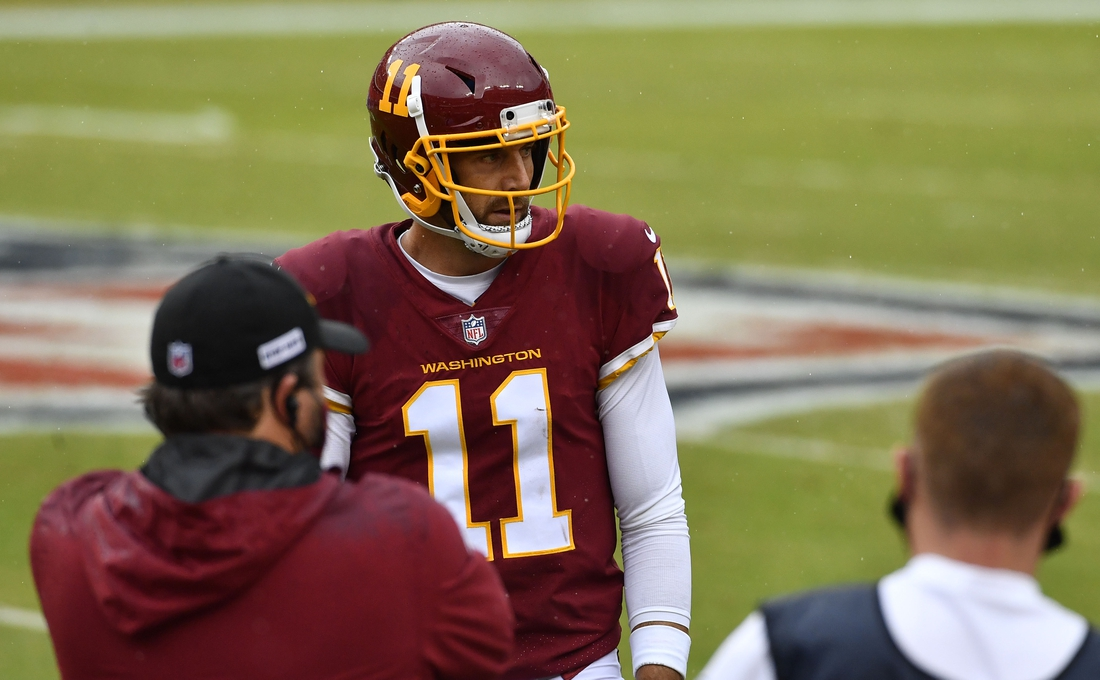 Oct 11, 2020; Landover, Maryland, USA; Washington Football Team quarterback Alex Smith (11) on the field against the Los Angeles Rams during the second quarter  at FedExField. Mandatory Credit: Brad Mills-USA TODAY Sports