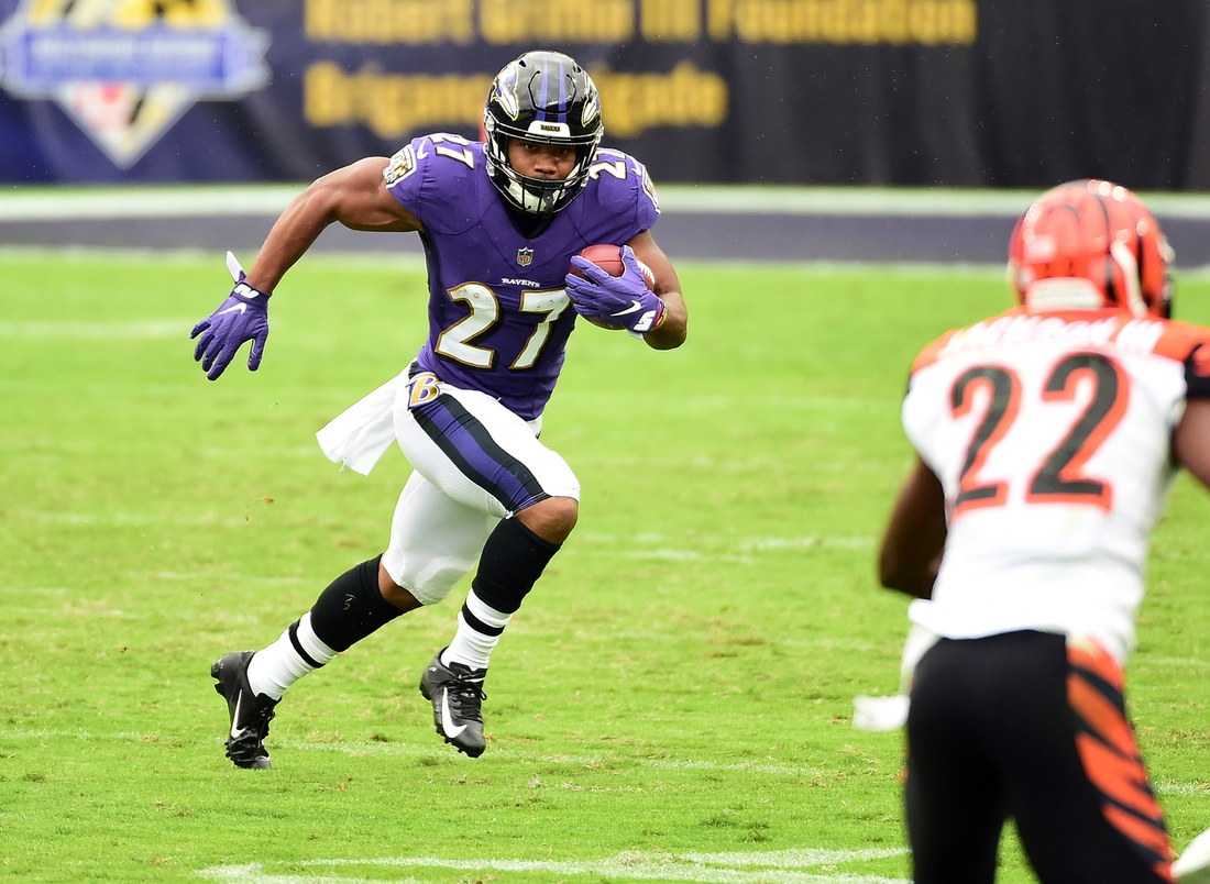 Oct 11, 2020; Baltimore, Maryland, USA; Baltimore Ravens running back J.K. Dobbins (27) runs with the ball in the second quarter against the Cincinnati Bengals at M&T Bank Stadium. Mandatory Credit: Evan Habeeb-USA TODAY Sports
