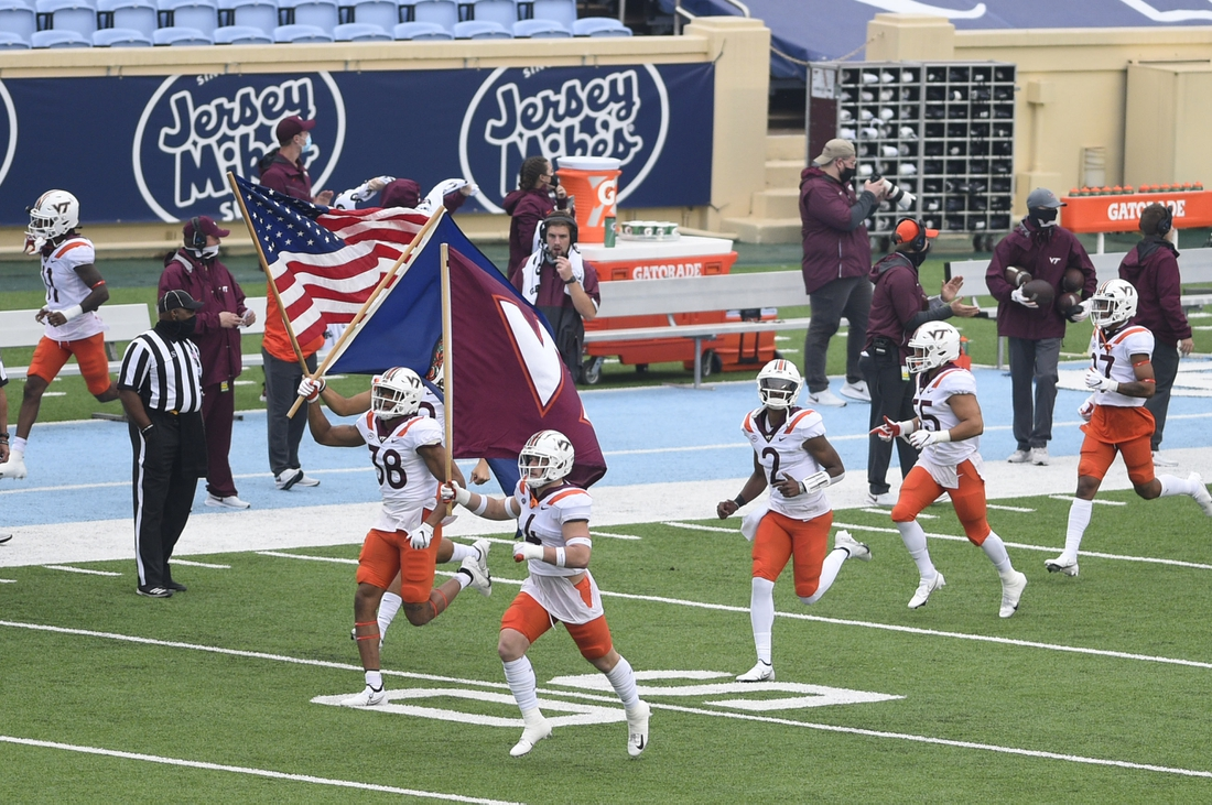 Oct 10, 2020; Chapel Hill, North Carolina, USA; Virginia Tech Hokies run on to the field before the game at Kenan Memorial Stadium. Mandatory Credit: Bob Donnan-USA TODAY Sports