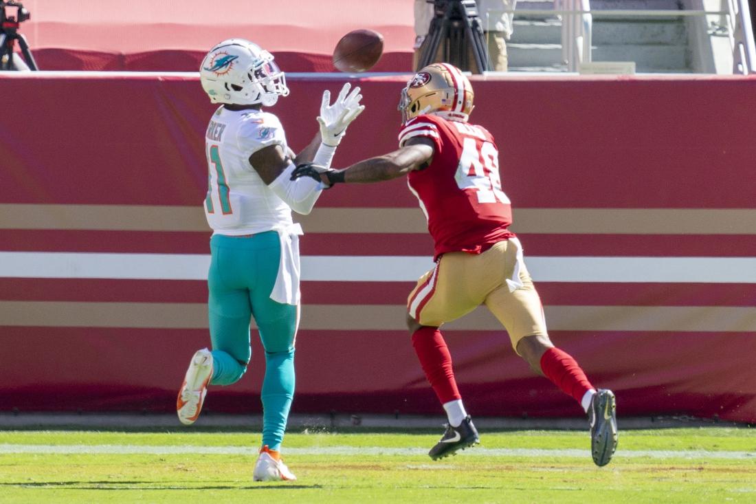 October 11, 2020; Santa Clara, California, USA; Miami Dolphins wide receiver DeVante Parker (11) catches a touchdown pass against San Francisco 49ers cornerback Brian Allen (48) during the second quarter at Levi's Stadium. Mandatory Credit: Kyle Terada-USA TODAY Sports