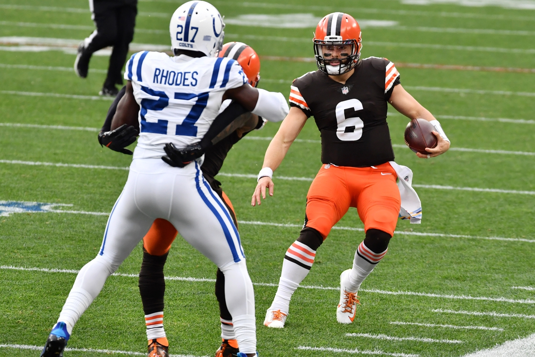 Oct 11, 2020; Cleveland, Ohio, USA; Cleveland Browns quarterback Baker Mayfield (6) runs with the ball as wide receiver Odell Beckham Jr. (13) blocks Indianapolis Colts cornerback Xavier Rhodes (27) during the first half at FirstEnergy Stadium. Mandatory Credit: Ken Blaze-USA TODAY Sports