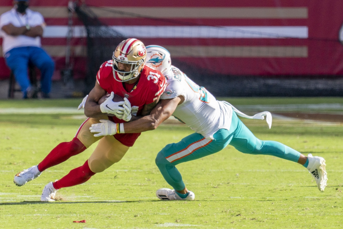 October 11, 2020; Santa Clara, California, USA; San Francisco 49ers running back Raheem Mostert (31) is tackled by Miami Dolphins outside linebacker Kamu Grugier-Hill (51) during the fourth quarter at Levi's Stadium. Mandatory Credit: Kyle Terada-USA TODAY Sports