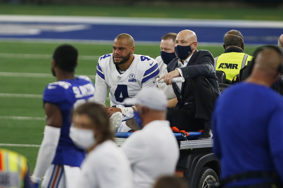 Oct 11, 2020; Arlington, Texas, USA; Dallas Cowboys quarterback Dak Prescott (4) leaves the field with an injury in the third quarter against the New York Giants at AT&T Stadium. Mandatory Credit: Tim Heitman-USA TODAY Sports