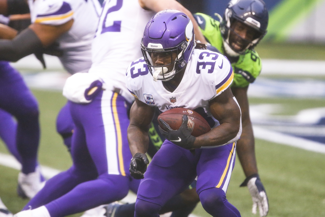 Oct 11, 2020; Seattle, Washington, USA; Minnesota Vikings running back Dalvin Cook (33) rushes against the Seattle Seahawks during the second quarter at CenturyLink Field. Mandatory Credit: Joe Nicholson-USA TODAY Sports