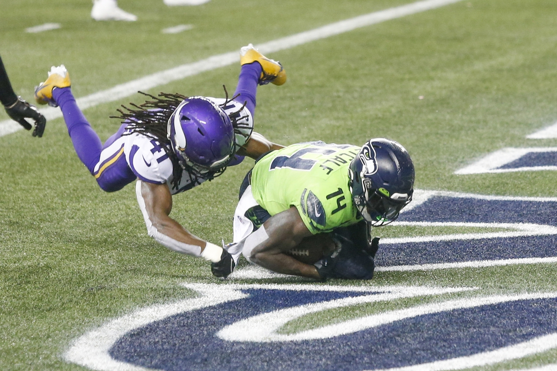 Oct 11, 2020; Seattle, Washington, USA; Seattle Seahawks wide receiver DK Metcalf (14) catches a touchdown pass against Minnesota Vikings free safety Anthony Harris (41) during the fourth quarter at CenturyLink Field. Mandatory Credit: Joe Nicholson-USA TODAY Sports