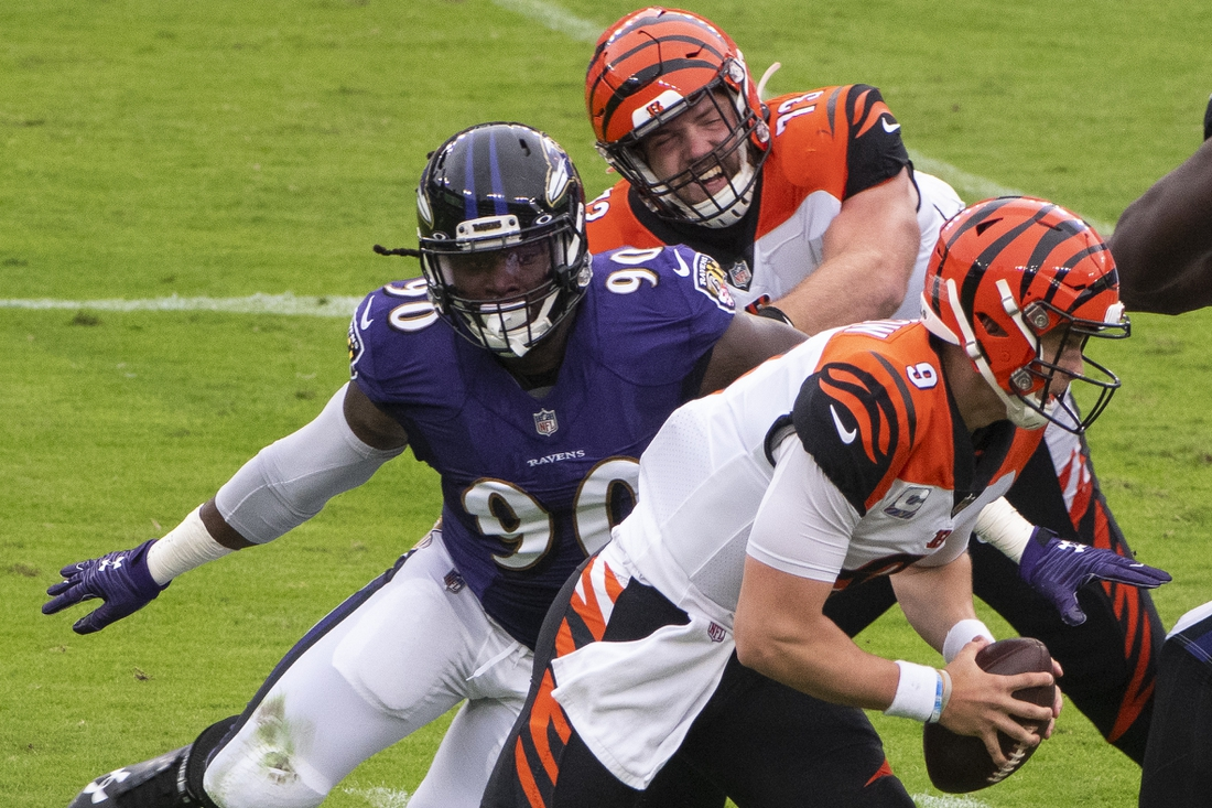 Oct 11, 2020; Baltimore, Maryland, USA;  Baltimore Ravens outside linebacker Pernell McPhee (90)rushes past Cincinnati Bengals offensive tackle Jonah Williams (73) as quarterback Joe Burrow (9) scramble during the first quarter at M&T Bank Stadium. Mandatory Credit: Tommy Gilligan-USA TODAY Sports
