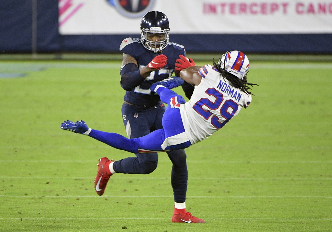 Oct 13, 2020; Nashville, Tennessee, USA;  Tennessee Titans running back Derrick Henry (22) throws Buffalo Bills cornerback Josh Norman (29) to the side from a stiff arm during the first half at Nissan Stadium. Mandatory Credit: Steve Roberts-USA TODAY Sports