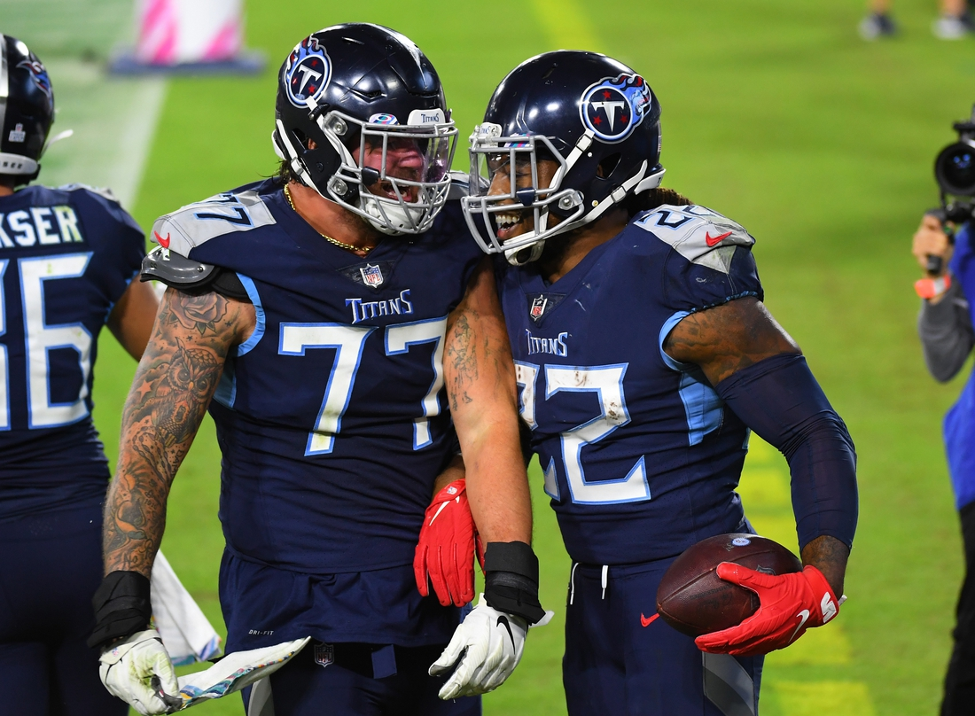 Oct 13, 2020; Nashville, Tennessee, USA; Tennessee Titans running back Derrick Henry (22) celebrates with Tennessee Titans offensive tackle Taylor Lewan (77) after a touchdown during the second half against the Buffalo Bills at Nissan Stadium. Mandatory Credit: Christopher Hanewinckel-USA TODAY Sports