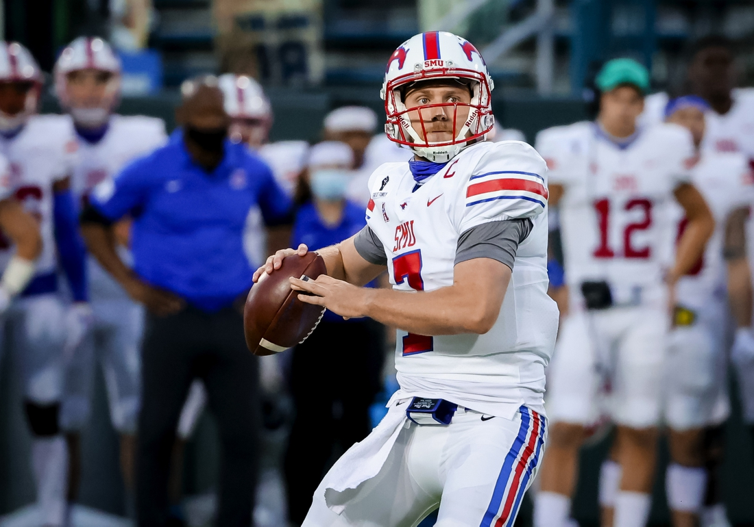 Oct 16, 2020; New Orleans, Louisiana, USA;  Southern Methodist Mustangs quarterback Shane Buechele (7) throws a touchdown against the Tulane Green Wave during the first half at Yulman Stadium. Mandatory Credit: Derick E. Hingle-USA TODAY Sports