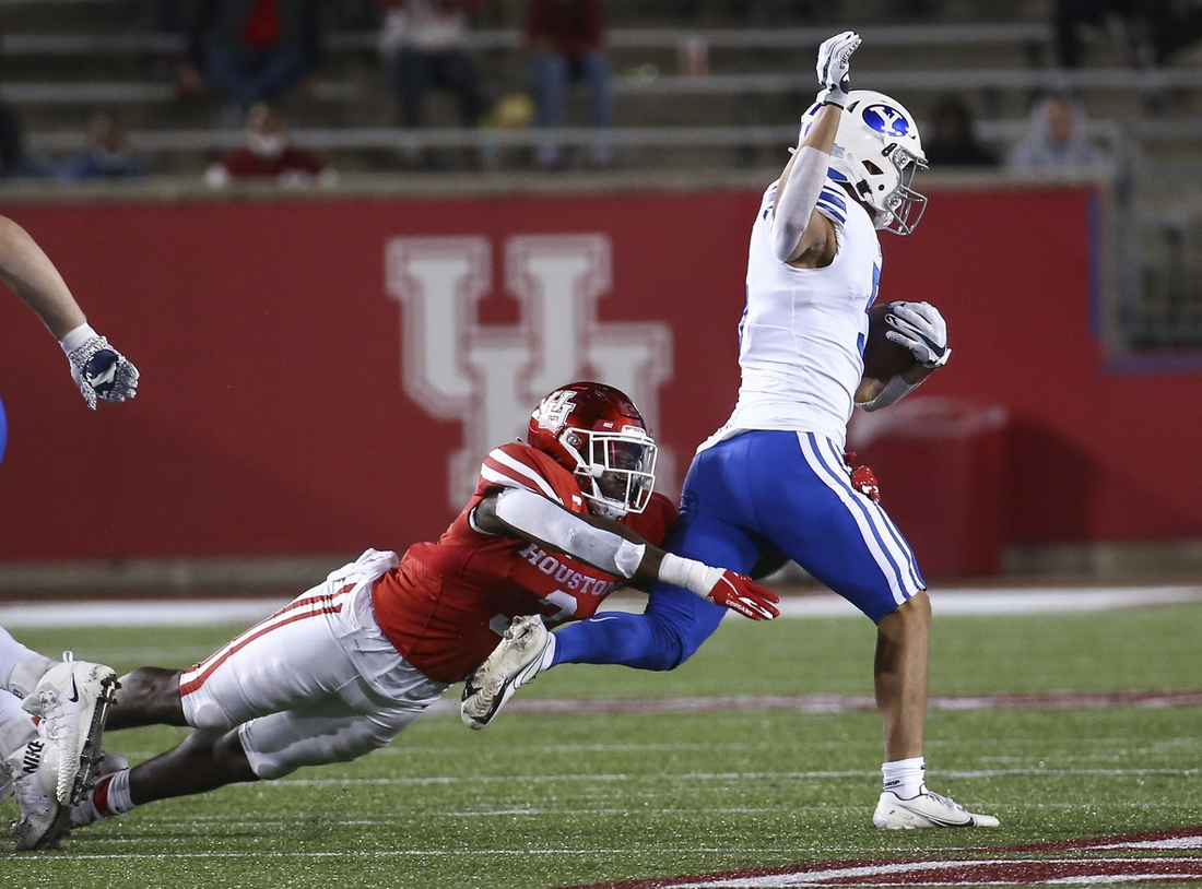 Oct 16, 2020; Houston, Texas, USA; Houston Cougars linebacker Donavan Mutin (3) attempts to tackle Brigham Young Cougars wide receiver Dax Milne (5) during the first quarter at TDECU Stadium. Mandatory Credit: Troy Taormina-USA TODAY Sports